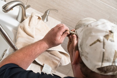 full service edmonton-plumber fixing sink